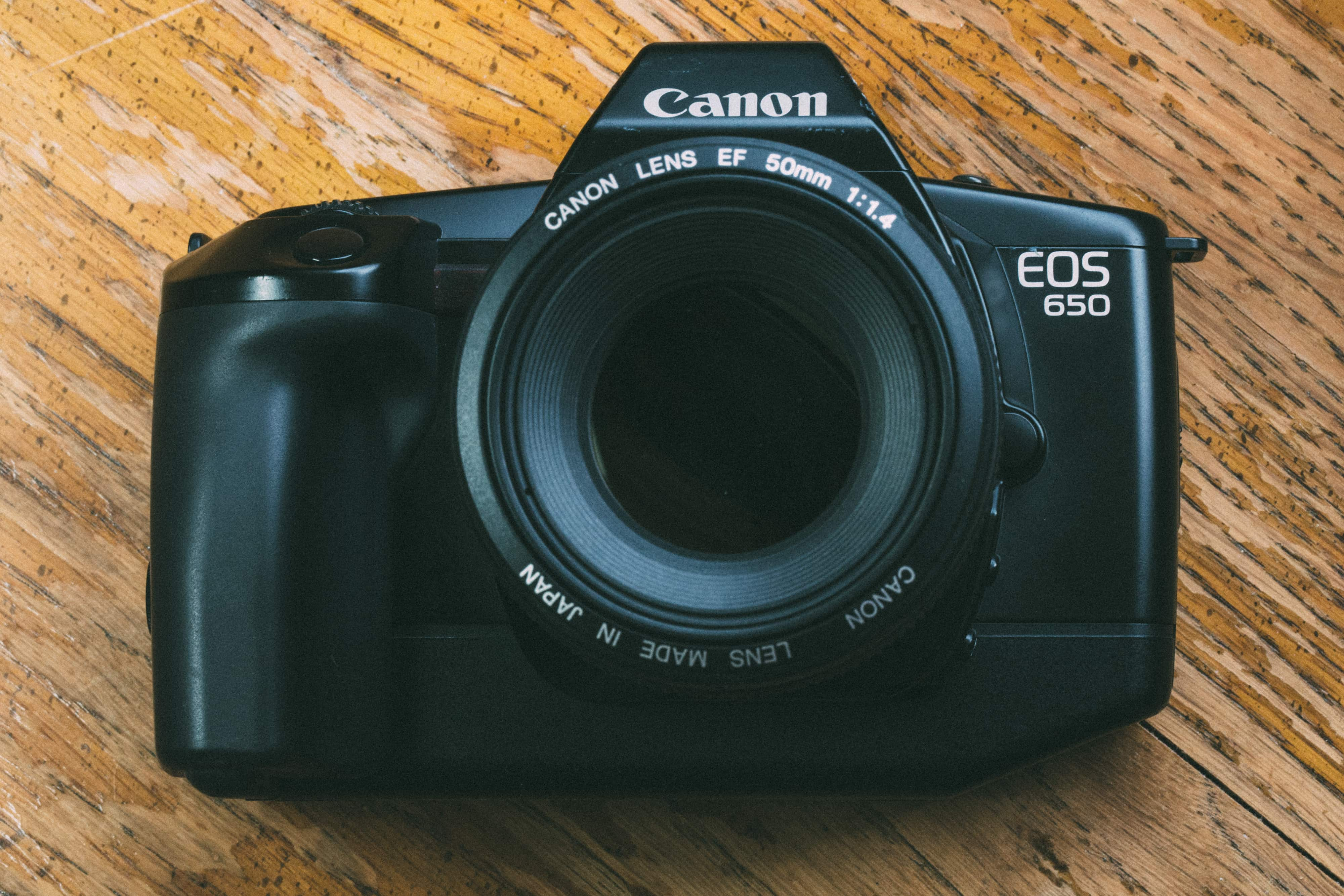 Canon eos 650 camera from front on wood background