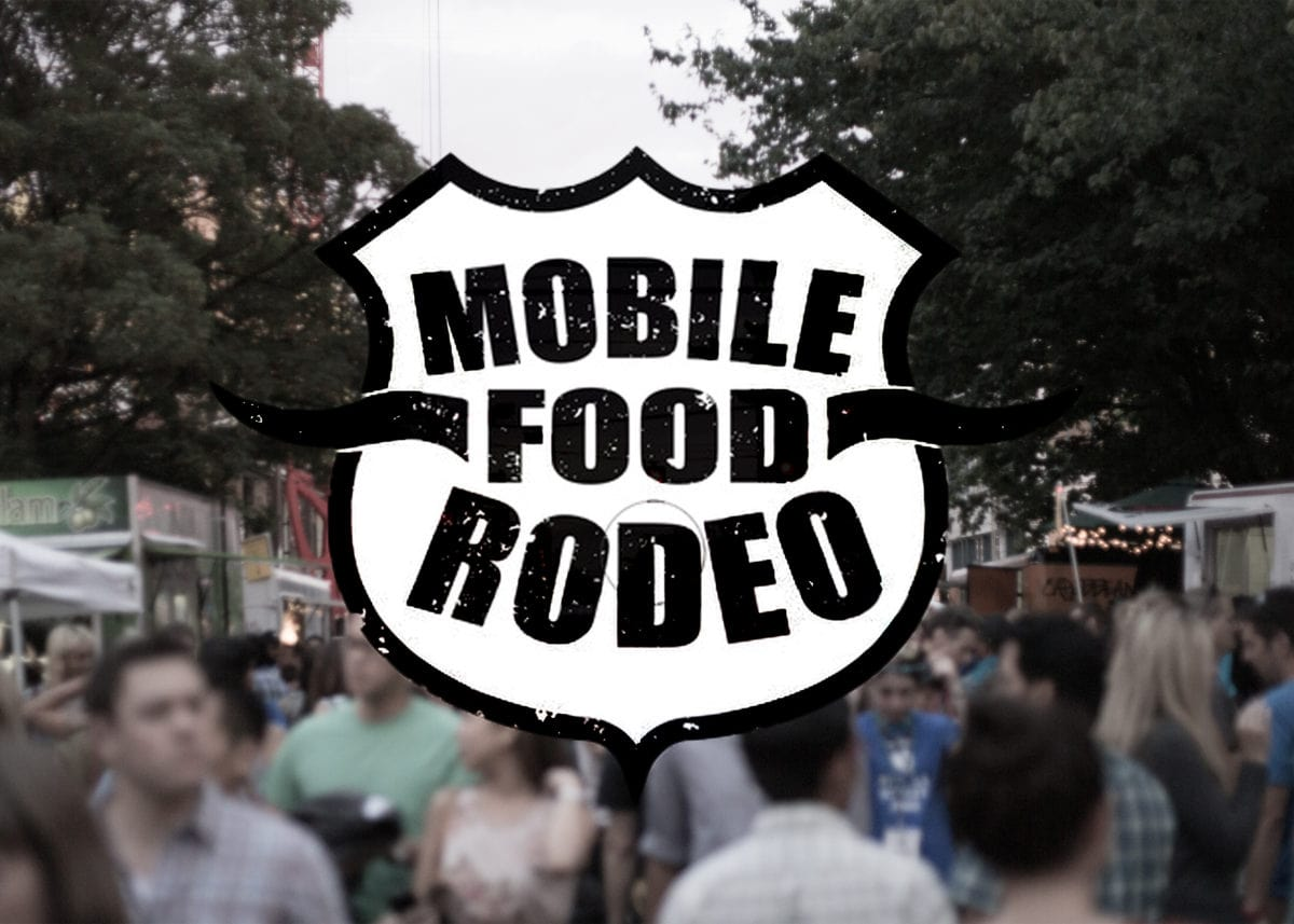 mobile food rodeo logo on blurry crowd image
